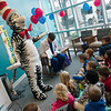 The Cat in the Hat and Ryan Longnecker, cardiologist at Freeman Hospital, read a Dr. Seuss book to students from St. Mary's Elementary on Monday at the hospital. In cooperation with Ozarks Public Television, Freeman Health System welcomed the Dr. Seuss character to read to students and pedriatric patients.<br /> Globe | Roger Nomer