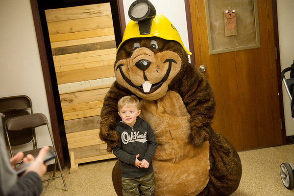 Colton Lauderdale, 3, Goodman, poses for a photo with a groundhog mascot during Wednesday's Preschool Nature Connections:  Goundhog Gets His Say, hosted by the Friends of Wildcat Glades, at the Joplin Empire Market.<br /> Globe | Roger Nomer