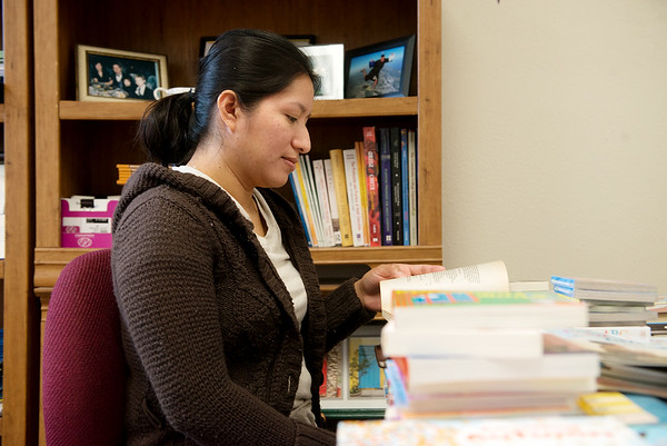 Mildred Villagres reads a book provided by a book drive at Crowder College on Wednesday.<br /> Globe | Roger Nomer