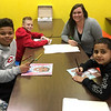 (left to right) Jaylon Daniels, Brayden Taylor and Brian Shepard of Boys & Girls Club of Southwest Missouri work on their portraits of influential African Americans as Cassidee Edwards, store manager for U.S. Cellular in Joplin, talked with the them about their inspirations. The artwork of the top 10 finalists in U.S. Cellular's Black History Month Art Contest, being held in conjunction with Boys & Girls Club of Southwest Missouri, is now on display at the U.S. Cellular store in Joplin. The creative pieces feature the image and likeliness of Jackie Robinson, Brandon Williams, Harriet Tubman, George Washington Carver, Martin Luther King Jr., President Barack Obama, Kevin Hart, Martin Luther King Jr. and Rosa Parks. Anyone 18 and older can visit the store through February 29 to vote for their favorite. Cash prizes will be awarded to the top three vote-getters. The art competition is part of U.S. Cellular's ongoing commitment to the local community.<br /> Courtesy Photo