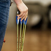 Jeremiah Jones, Carl Junction High junior, picks up an arrow during archery practice on Monday in Carl Junction.<br /> Globe | Roger Nomer