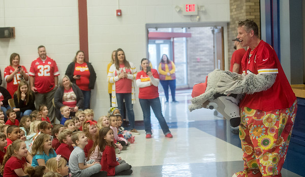 Dan Meers, as KC Wolf, removes his mascot costume during an assembly at Cecil Floyd Elementary on Thursday.<br /> Globe | Roger Nomer