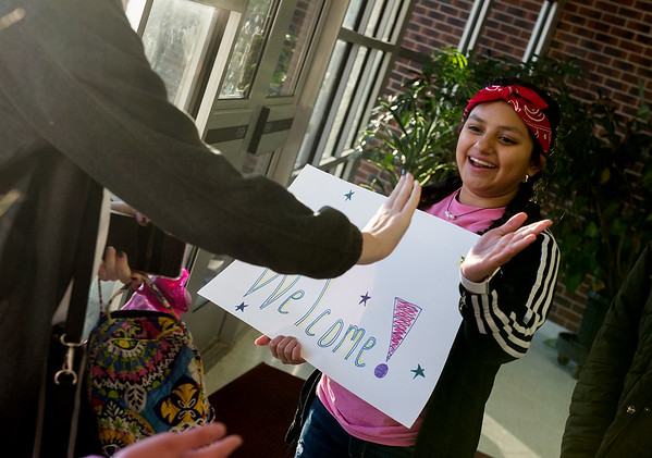 Letzy Poroj, eighth grader at Carl Junction Junior High School, high fives arriving students on Friday morning as part of the Kids Recognizing Everyone's Worth group.<br /> Globe | Roger Nomer