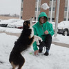 Maegen Derfelt, a Missouri Southern freshman from Carl Junction, tosses a snowball to her dog Athena on Wednesday.<br /> Globe | Roger Nomer