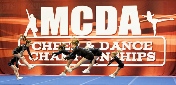 Cheerleaders from the Midwest Storm Blitz compete in the junior division during the Midwest Cheer and Dance Championships on Saturday at Galena High School. The St. Joseph based squad was one of dozens competing in the event sponsored by the Joplin Sports Authority.<br /> Globe | Laurie Sisk