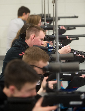 Gabe Elder, freshman at Webb City High School, reloads his rifle during practice on Tuesday at the school.<br /> Globe | Roger Nomer