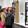 On Tuesday at the Joplin Public Library, parents and students check out projects for the upcoming National History Day, Region 6 Contest on  March 6 at Missouri Southern. Regional winners move on to the state and national contests.<br /> Globe | Laurie Sisk