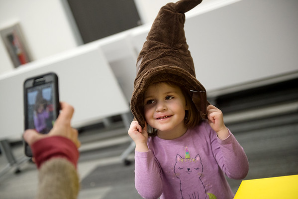 Norah Cooney, 3, tries on the Sorting Hat during Harry Potter Day at the Joplin Public Library on Friday.<br /> Globe | Roger Nomer