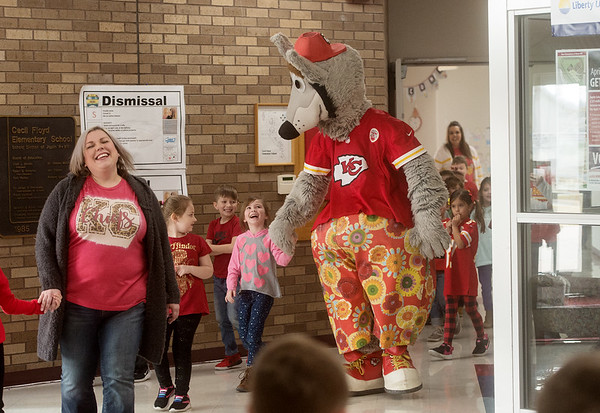 Dan Meers, as KC Wolf, escorts students to an assembly on Thursday at Cecil Floyd.<br /> Globe | Roger Nomer