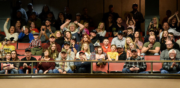 A large crowd cheers on the cowboys during the LJ Jenkins Bull Riding Tour Finals on Saturday night at Memorial Hall.<br /> Globe   Laurie Sisk
