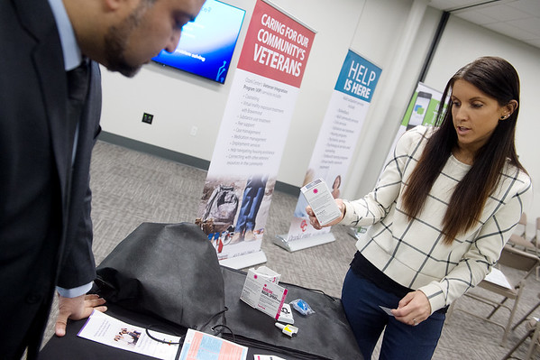 Nauman Ashraf, director of addiction services at Ozark Center, and Allison Smith, physician at Ozark Center, talk about a drug used to treat an opioid overdose on Wednesday at Ozark Center.<br /> Globe | Roger Nomer