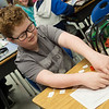 Carson Barley, fourth grader at Pleasant Valley Elementary in Carthage, works on a class assignment on Friday. Barley was one of the students identified as needing glasses by a screening test at the school.<br /> Globe | Roger Nomer