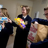 (from left) Future Farmers of America members Aubrey Niess, Evelyn Gilbreath, juniors at Carl Junction High School, and Gray Cravens, freshman at Joplin High School, helps stock donations from the  Missouri Farm Bureau on Tuesday at the Ronald McDonald House in Joplin.<br /> Globe | Roger Nomer