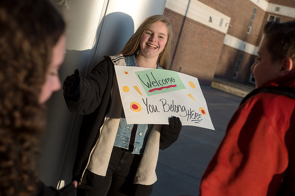 Addison Carroll, eighth grader at Carl Junction Junior High, welcomes students to school on Friday as part of the Kids Recognizing Everyone's Worth group.<br /> Globe | Roger Nomer