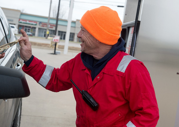 Paul Schaefer, owner of Doc's Stop, accepts payment for a fill up on Monday as part of the station's full service.<br /> Globe   Roger Nomer
