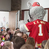 Dan Meers, as KC Wolf, greets students at Cecil Floyd Elementary on Thursday morning.<br /> Globe | Roger Nomer