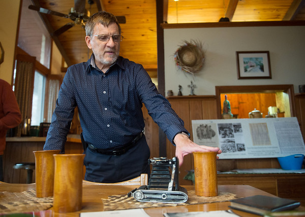 Brad Baker talks about some of the items his mother Norma kept secretly at the Los Banos camp, including wooden mugs and a camera.<br /> Globe | Roger Nomer