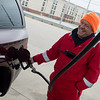 Paul Schaefer, owner of Doc's Stop, fills up a customer's vehicle on Monday as part of the store's full service.<br /> Globe | Roger Nomer