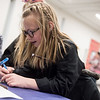 Annabelle Lucas, 8, works on decorating her wand during Harry Potter Day at the Joplin Public Library on Friday.<br /> Globe | Roger Nomer