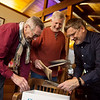 (from left) Brothers Bret, Kurt and Brad Baker look through a box related to their family history on Feb. 10 in Webb City.<br /> Globe | Roger Nomer