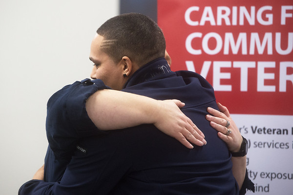 Michael Dobson gets a hug from Lisa Watson, peer support specialist at Ozark Center, after sharing his story of recovery from opioid addiction on Wednesday at Ozark Center.<br /> Globe | Roger Nomer
