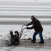 Ino Hernandez clears a sidewalk at the Gryphon Building on Wednesday morning.<br /> Globe | Roger Nomer