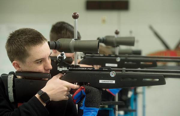 Zachary Chronister, sophomore at Webb City High School, practices with a rifle on Tuesday at the school.<br /> Globe | Roger Nomer