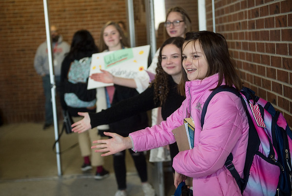 Mae Cameron, seventh grader at Carl Junction Junior High School, welcomes students to class on Friday as part of the Kids Recognizing Everyone's Worth group.<br /> Globe | Roger Nomer