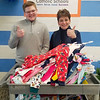 St. Mary's Principal Joanne Lown is pictured donating 82 pajamas and $140 to Easton Murdock, a former St. Mary's student and the founder of Operation Jammies. The charity donates pajamas to children staying in area hospitals and shelters to ensure children have cozy clothes to sleep in during difficult times. St. Mary's collected the pajamas as one of the school's acts of charity and compassions during Catholic Schools Week. <br /> Courtesy Photo