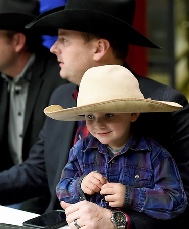 Three-year-old Kord Lee, of Siloam Springs, Ark., assists his dad, event producer Jeff Lee, during the LJ Jenkins Bull Riding Tour Finals on Saturday night at Memorial Hall.<br /> Globe | Laurie Sisk