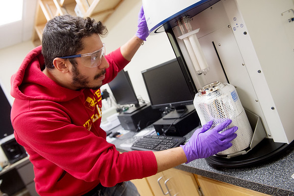 Felipe Souza, graduate student at Pittsburg State University, demonstates measuring the surface area of battery material on Tuesday at PSU's Kansas Polymer Research Center in Pittsburg.<br /> Globe | Roger Nomer