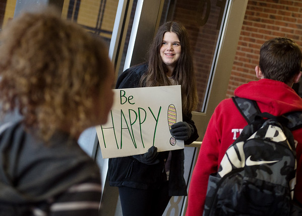 Tallie Ayton, seventh grader at Carl Junction Junior High School, welcomes students to school on Friday as part of the Kids Recognizing Everyone's Worth group.<br /> Globe | Roger Nomer