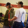 Lane Stone (left), Carl Junction High senior, and Jeremiah Jones, junior, practice with the Carl Junction archery team on Monday in Carl Junction.<br /> Globe | Roger Nomer