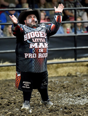 """Josh Garrick, aka """"Pork Chop: The Biggest Little Man in Pro Rodeo"""" entertains the crowd between riders during the LJ Jenkins Bull Riding Tour Finals on Saturday night at Memorial Hall.<br /> Globe   Laurie Sisk"""