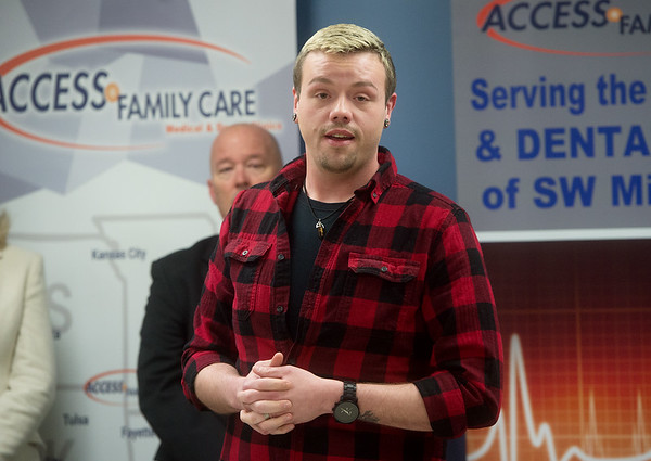 Patrick Burrows talks about his life without medical insurance on Thursday at Access Family Care. Globe | Roger Nomer