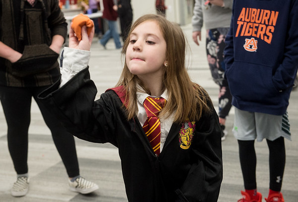 Calleigh Anderson, 7, takes aim for a game of Quidditch during Harry Potter Day at the Joplin Public Library on Friday.<br /> Globe | Roger Nomer