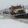 A Missouri Department of Transportation snow plow clears Range Line Road on Wednesday.<br /> Globe | Roger Nomer