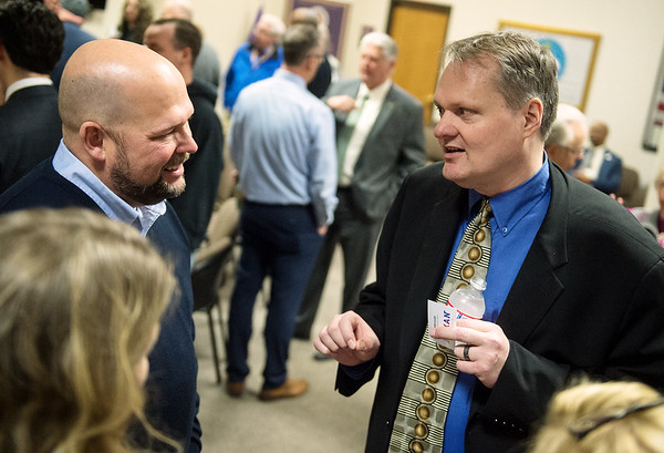 Brad Hodson (left), executive vice president at Missouri Southern State University, talks with city manager candidate Shawn Henessee during a public meet and greet at Joplin City Hall on Monday. Globe | Roger Nomer