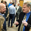 Brad Hodson (left), executive vice president at Missouri Southern State University, talks with city manager candidate Shawn Henessee during a public meet and greet at Joplin City Hall on Monday.<br /> Globe | Roger Nomer