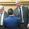 Joplin's new City Manager Nick Edwardsgreets Mike Landis a press conference on Wednesday at Joplin City Hall. Also pictured is Joplin Mayor Gary Shaw<br /> Globe | Laurie Sisk