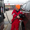 Paul Schaefer, owner of Doc's Stop, fills up a vehicle on Monday as part of the station's full service offering.<br /> Globe | Roger Nomer