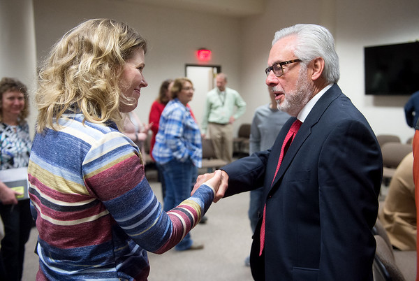 Lori Haun, Downtown Joplin Alliance executive director, talks with city manager candidate Leonard Sossamon during a public meet and greet at Joplin City Hall on Monday.<br /> Globe | Roger Nomer