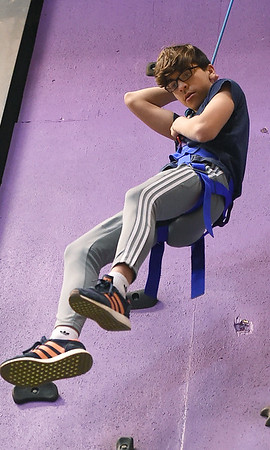 Braiden Windle, 14, rappells down the karge climbing wall at Victory Ministry and Sports Complex on Saturday while spending time with his Big Brother, Mike Brown.<br /> Globe | Laurie Sisk