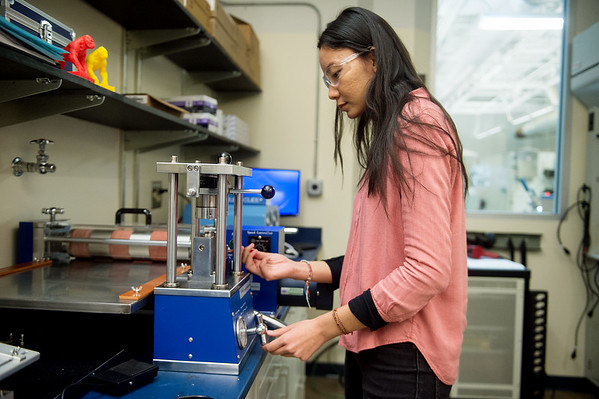 Tenzin Ingsel, graduate student at Pittsburg State University, demonstrates the process of packing a battery on Tuesday at PSU's Kansas Polymer Research Center in Pittsburg.<br /> Globe | Roger Nomer