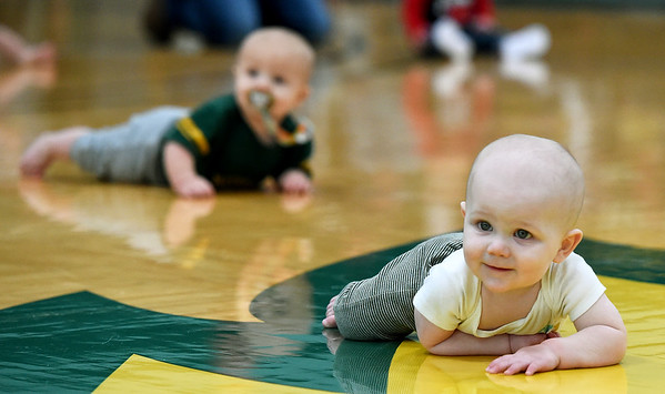 Seven month old Hudson Tupman, front, races to a first place finish as 10-month-old Rex Doak tries to narrow the gap during the Diaper Dash at halftime of the Missouri Southern/Rogers State basketball game on Saturday at Leggett & Platt.<br /> Globe   Laurie Sisk