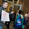 Luke Battagler, eighth grader at Carl Junction Junior High School, welcomes students to school on Friday as part of the Kids Recognizing Everyone's Worth group.<br /> Globe | Roger Nomer