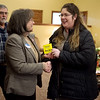 Sylvia Garnett (left), secretary and treasurer for Newton County Farm Bureau, gives a donation from the bureau to Shirley Hylton, program coordinator for the Ronald McDonald House. The donation was one of several from area farm bureaus to the Ronald McDonald House in Joplin on Tuesday.<br /> Globe | Roger Nomer