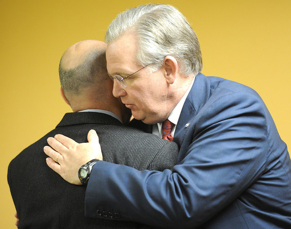Globe/T. Rob Brown<br /> Missouri Gov. Jay Nixon hugs Mark Norton, father of Will Norton, at Will's Place, a healing center for kids and part of Ozark Center, on West 30th Street in Joplin Tuesday afternoon, Jan. 10, 2012. The facility is named after Will Norton, a Joplin High School student who had just graduated May 22, 2012, before the tornado took his life.