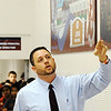 Globe/T. Rob Brown<br /> Joplin High School Assistant Principal Matthew Harding speaks to students Tuesday morning, Jan. 10, 2012, under a series of new wall murals by Carthage artist Sherry Pettey depicting Joplin High School before and after the May 22, 2011, tornado. The murals, currently hanging in the Memorial School 9th- and 10th-grade campus, were first shown to the public during a 10 a.m. ceremony attended by the artist. After completion of a new Joplin High School, the murals will be moved there.