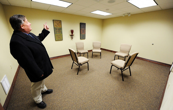 Globe/T. Rob Brown<br /> Tom Moore, a professional engineer and an elder with the Kingdom Hall of Jehova's Witnesses, shows Friday morning, Jan. 27, 2012, a tornado-safe room inside the new hall at 13th Street and Schifferdecker Avenue, which was built since the tornado. This room has a heavy, metal, reinforced door, a thicker ceiling and walls but otherwise looks like a regular conference room.